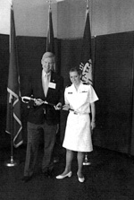Past Governor MD-OFPA Fritz Briggs presents Midshipman First Class Kelly Irene Knorr with the Admiral Dewey Award in Annapolis, MD