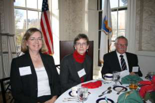 Maureen Taylor, Exec Sec Deborah Nowers and Governor Henry Peach await the beginning of lunch.